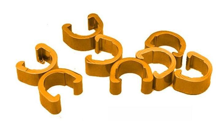 Příchytka hydraulické brzdové hadice a bowdenu podkova AL zlatá 1ks Velo
